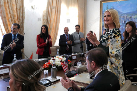Stock Picture of Ivanka Trump, Saadeddine el-Othmani. Ivanka Trump, the daughter and senior adviser to President Donald Trump, right, stands up and applauds at the completion of a signing ceremony attended by Prime Minister of Morocco Saadeddine el-Othmani, far left, and other officials, in Rabat, Morocco