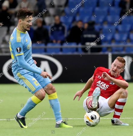 AZ Alkmaar Dani de Wit (R) fights for the ball with Antonio Rukavina (L) of Astana during the UEFA Europa League match between FK Astana and AZ Alkmaar at the Astana Arena stadium in  Nur-Sultan, Kazakhstan, 07 November 2019.