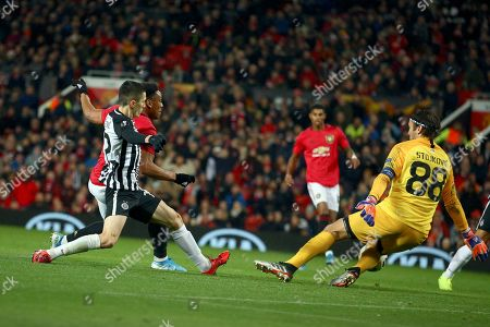 Manchester United's Anthony Martial, 2nd left, scores his side's second goal past Partizan's goalkeeper Vladimir Stojkovic, right, during the Europa League group L soccer match between Manchester United and FK Partizan at Old Trafford Stadium in Manchester, England