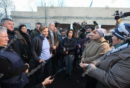 Anka Feldhusen (C-L), the ambassador of Germany to Ukraine, Etienne de Poncins (C), French Ambassador to Ukraine and Melinda Simmons (C-R), British Ambassador to Ukraine meet with locals in the Zolote of Luhansk area, Ukraine, 07 November 2019, as they visit the Eastern-Ukrainian conflict zone. Ukraine has invited foreign diplomats to show them its engagement in resolving the war in Eastern Ukraine as well as its commitment to the Normandy Format talks. The disengagement of troops and weapons near the villages of Bohdanivka and Petrivske in Donbas from both sides is planned for 08 November 2019, in case the shelling will not be extended.