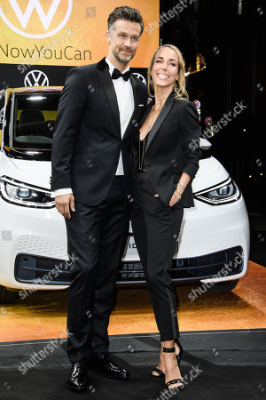 German actor Wayne Carpendale (L) and his wife Annemarie Warnkross arrive for the GQ Men of the Year 2019 awards show in Berlin, Germany, 07 November 2019. The international monthly men's magazine GQ presents the award to personalities from the show and music businesses as well as society, sport, politics, culture and fashion.