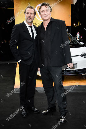 German actors Sebastian Koch (L) and Oliver Masucci arrive for the GQ Men of the Year 2019 awards show in Berlin, Germany, 07 November 2019. The international monthly men's magazine GQ presents the award to personalities from the show and music businesses as well as society, sport, politics, culture and fashion.