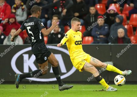 Maxime Lestienne (R) of Standard de Liege  in action against Frankfurt's Gelson Fernandes (L) during the UEFA Europa League group F match between Standard de Liege and Eintracht Frankfurt, in Liege, Belgium, 07 November 2019.