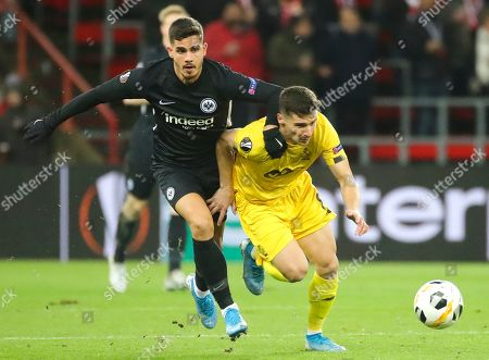 Timothy Galje (R) of Standard de Liege  in action against Frankfurt's Andre Silva (L) during the UEFA Europa League group F match between Standard de Liege and Eintracht Frankfurt, in Liege, Belgium, 07 November 2019.