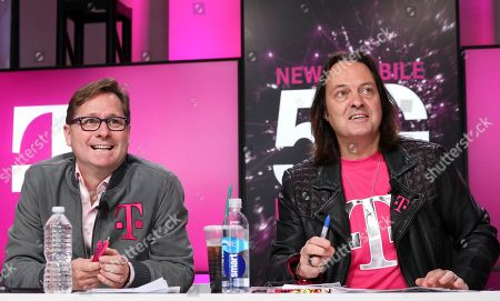 Stock Photo of Mike Sievert, John Legere. Un-carrier President Mike Sievert and CEO John Legere answer caller questions during the announcement of the future New T-Mobile's Un-carrier Moves, in New York. The Un-carrier unveiled three new initiatives for the proposed combination of T-Mobile and Sprint including the Connecting Heroes Initiative, a 10-year commitment to providing free unlimited talk, text and smartphone data for public and non-profit U.S. state and local law enforcement, fire and EMS agencies
