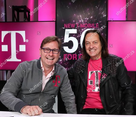 Stock Image of Mike Sievert, John Legere. IMAGE DISTRIBUTED FOR T-MOBILE - T-Mobile President Mike Sievert and CEO John Legere are all smiles while announcing the future New T-Mobile's first three Un-carrier Moves, in New York. T-Mobile is laying the groundwork for New T-Mobile to change wireless for good with plans for three new initiatives, including Project 10Million, a new program designed to eliminate the homework gap by offering free service, hotspots and reduced cost devices to 10 million underserved households over five years