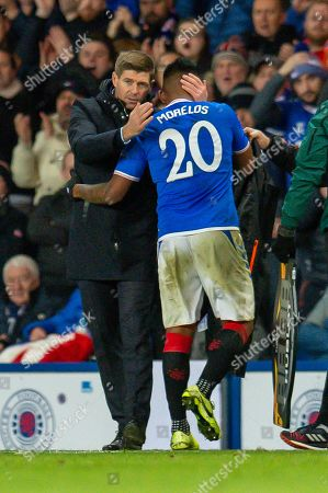 Steven Gerrard, manager of Rangers FC congratulates Alfredo Morelos (#20) of Rangers FC as he is substituted during the Group G Europa League match between Rangers FC and FC Porto at Ibrox Stadium, Glasgow