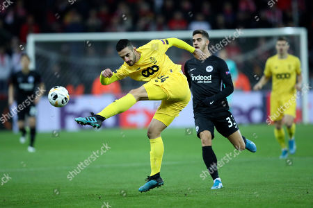 Liege's Konstantinos Laifis, left, tussles for the ball with Frankfurt's Andre Silva during the Europa League Group F soccer match between Standard Liege and Eintracht Frankfurt at the Maurice Dufrasne stadium in Liege, Belgium