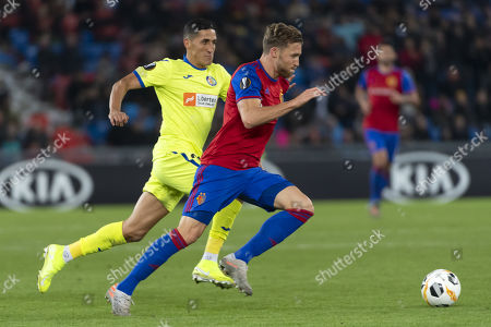 Getafe's Faycal Fajr (L) fights for the ball against Basel's Silvan Widmer (R) during the  UEFA Europa League group C soccer match between Switzerland's FC Basel 1893 and Spain's Getafe CF at the St. Jakob-Park stadium in Basel, Switzerland, 07 November 2019.