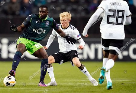 Stock Photo of Yannick Bolasie (L) of Sporting and Birger Meling of Rosenborg in action during the UEFA Europa League match Sporting Lisboa vs Rosenborg in Trondheim, Norway, 07 November 2019.
