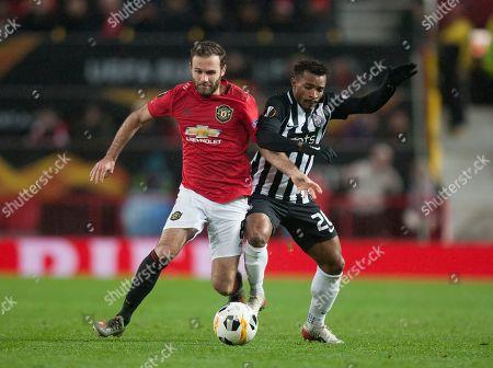 Stock Image of Juan Mata of Manchester United (L) and Seydouba Soumah of Partizan in action
