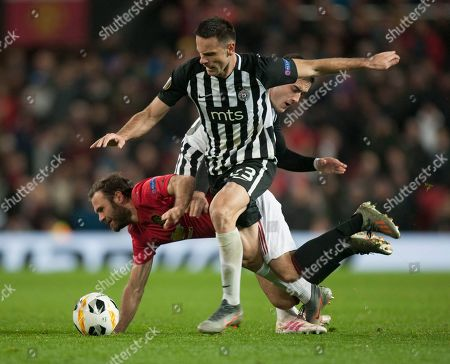 Juan Mata of Manchester United (C) is fouled by Bojan Ostojic of Partizan