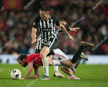 Stock Picture of Juan Mata of Manchester United (C) is fouled by Bojan Ostojic of Partizan
