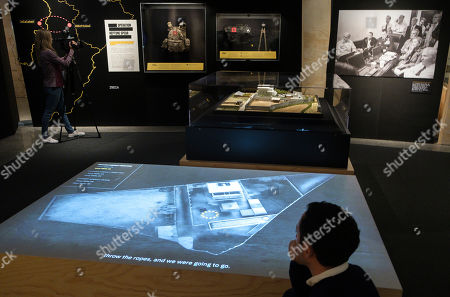A man looks at a video and the model used by military personal to plan the raid that lead to the death of Osama Bin Laden at a new exhibit 'Revealed: The Hunt for Bin Laden' at the 9/11 Memorial Museum in New York, New York, USA, 07 November 2019. The exhibit, which opens on 15 November 2019, looks at the United States? decades-long search for Bin Laden which culminated with the Seal Team Six raid on his hideout in Pakistan in 2011.