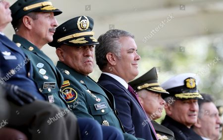 Ivan Duque, Luis Fernando Navarro. Colombia's Interim Defense Minister and Commander of the Armed Forces Gen. Luis Fernando Navarro, second from left, sits with Colombia's President Ivan Duque, center, during a graduation ceremony for police cadets in Bogota, Colombia, . Colombia's Defense Minister Guillermo Botero resigned Wednesday after a lawmaker accused him of failing to disclose that eight minors had been killed in a military operation against dissident rebels