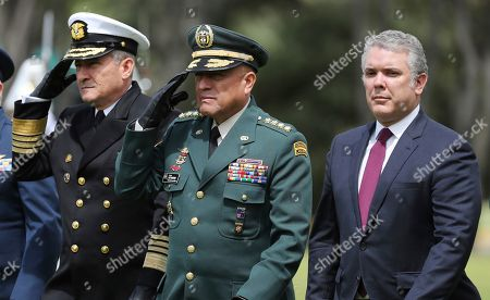 Ivan Duque, Luis Fernando Navarro. Colombia's Interim Defense Minister and Armed Forces Commander Gen. Luis Fernando Navarro, center, and Colombia's President Ivan Duque, right, attend a graduation ceremony for police cadets in Bogota, Colombia, . Colombia's Defense Minister Guillermo Botero resigned Wednesday after a lawmaker accused him of failing to disclose that eight minors had been killed in a military operation against dissident rebels