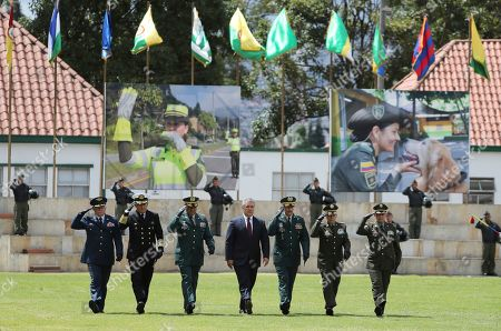Ivan Duque, Luis Fernando Navarro. Colombia's President Ivan Duque, center, walks with his military staff at a graduation ceremony for police cadets in Bogota, Colombia, . Colombia's Defense Minister Guillermo Botero resigned Wednesday after a lawmaker accused him of failing to disclose that eight minors had been killed in a military operation against dissident rebels