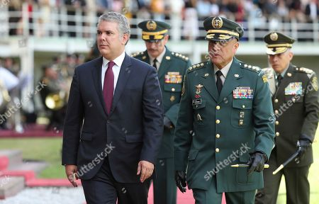 Ivan Duque, Luis Fernando Navarro. Colombia's Interim Defense Minister and Armed Forces Commander Gen. Luis Fernando Navarro, front right, walks with Colombia's President Ivan Duque at a graduation ceremony for police cadets in Bogota, Colombia, . Colombia's Defense Minister Guillermo Botero resigned Wednesday after a lawmaker accused him of failing to disclose that eight minors had been killed in a military operation against dissident rebels
