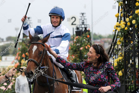 Stock Photo of , Melbourne, Miami Bound with Damien Oliver up and Nina O'Brien, wife of trainer Danny O'Brien, after winning the Kennedy Oaks at Flemington racecourse, AUS.