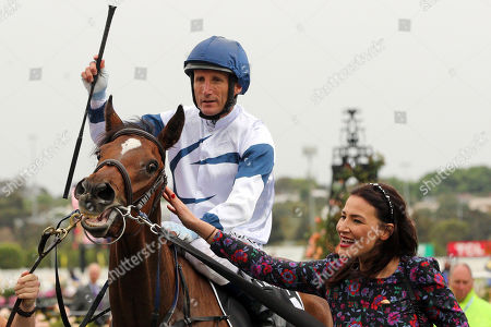 , Melbourne, Miami Bound with Damien Oliver up and Nina O'Brien, wife of trainer Danny O'Brien, after winning the Kennedy Oaks at Flemington racecourse, AUS.