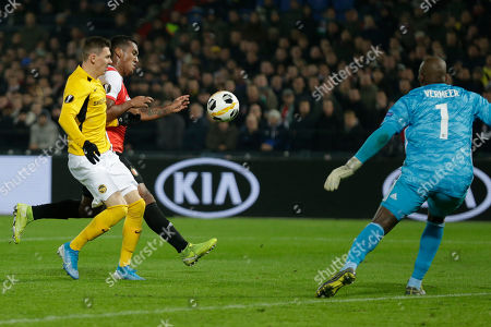 Feyenoord's Renato Tapia, second left, saves before Young Boys' Christian Fassnacht, left, can shoot on goal as Feyenoord's goalkeeper Kenneth Vermeer blocks, right, during a Europa League group G soccer match between Feyenoord and Young Boys at De Kuip stadium in Rotterdam, Netherlands