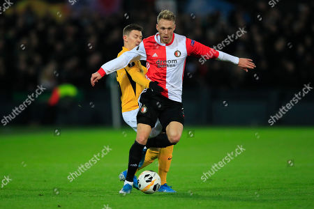 Young Boys' Christian Fassnacht, left, and Feyenoord's Nicolai Jorgensen vie for the ball during a Europa League group G soccer match between Feyenoord and Young Boys at De Kuip stadium in Rotterdam, Netherlands
