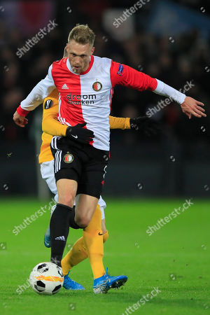 Young Boys' Christian Fassnacht, rear, uses his arm to hold back Feyenoord's Nicolai Jorgensen during a Europa League group G soccer match between Feyenoord and Young Boys at De Kuip stadium in Rotterdam, Netherlands