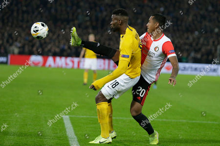 Feyenoord's Renato Tapia, right, clears the ball before Young Boys' Jean-Pierre Nsame, left, during a Europa League group G soccer match between Feyenoord and Young Boys at De Kuip stadium in Rotterdam, Netherlands