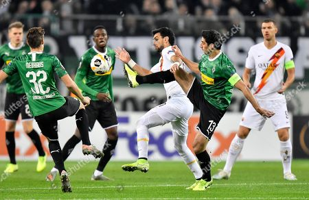 Moenchengladbach's Lars Stindl, right, and Roma's Javier Pastore challenge for the ball during the Europa League Group J soccer match between Borussia Moenchengladbach and AS Roma in Moenchengladbach, Germany