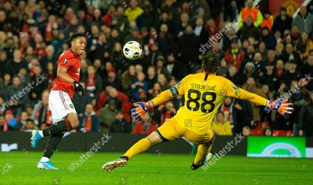 Manchester United's Anthony Martial (L) in action with FK Partizan's Vladimir Stojkovic (R)  during the UEFA Europa League group L soccer match between Manchester United and FK Partizan held at Old Trafford in Manchester, Britain, 07 November 2019.