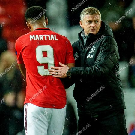 Manchester United manager Ole Gunnar Solskjaer reacts with Manchester United's Anthony Martial (L) during the UEFA Europa League group L soccer match between Manchester United and FK Partizan held at Old Trafford in Manchester, Britain, 07 November 2019.