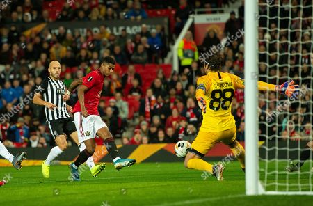 Manchester United's Marcus Rashford (L) in action with FK Partizan's Vladimir Stojkovic (R) during the UEFA Europa League group L soccer match between Manchester United and FK Partizan held at Old Trafford in Manchester, Britain, 07 November 2019.