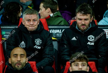 Manchester United manager Ole Gunnar Solskjaer (L) reacts during the UEFA Europa League group L soccer match between Manchester United and FK Partizan held at Old Trafford in Manchester, Britain, 07 November 2019.