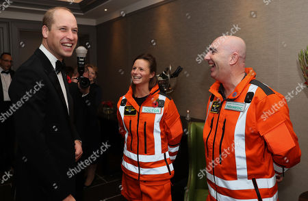 Prince William shares a joke with Doctor Flora Bird, Consultant in emergency medicine at the Royal London Hospital and Paramedic Steve Jones about how clean their uniforms are