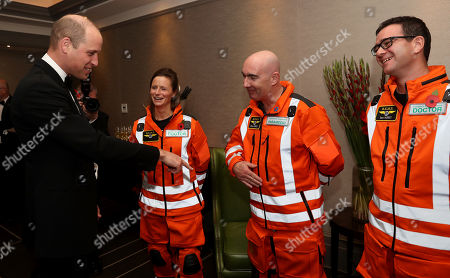 Prince William shares a joke with Doctor Flora Bird, Consultant in emergency medicine at the Royal London Hospital, Paramedic Steve Jones and Dr Tom Hurst, Consultant with London Air Ambulance about how clean their uniforms are