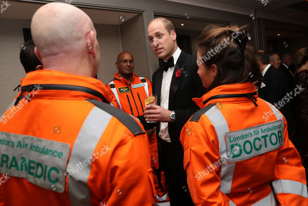 Prince William speaks with Doctor Flora Bird, Consultant in emergency medicine at the Royal London Hospital, Paramedic Steve Jones and Doctor John Chatterjee, Anaesthetic Consultant at Guys and St Thomas Hospitals