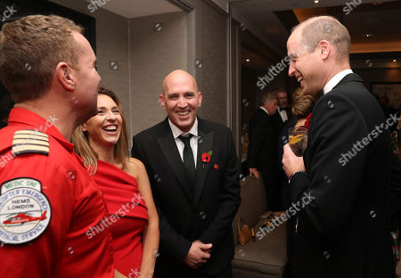 Stock Photo of Prince William speaks with Captain Andy Thompson and Yair Shahar, a patient who was in a road traffic collision