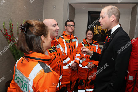 Prince William speaks with Doctor Flora Bird, Consultant in emergency medicine at the Royal London Hospital, Paramedic Steve Jones, Dr Tom Hurst, Consultant with London Air Ambulance and Paramedic Laura Mannes