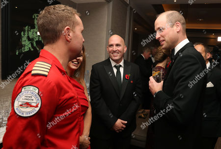 Stock Picture of Prince William speaks with Captain Andy Thompson and Yair Shahar, a patient who was in a road traffic collision