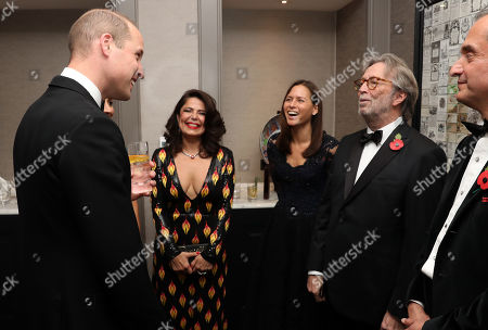 Prince William with Eric Clapton and guests as he attend the London's Air Ambulance Charity gala.