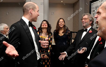 Prince William and Eric Clapton attend the London's Air Ambulance Charity gala.