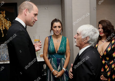 Prince William with Bernie Ecclestone and guests as he attend the London's Air Ambulance Charity gala.