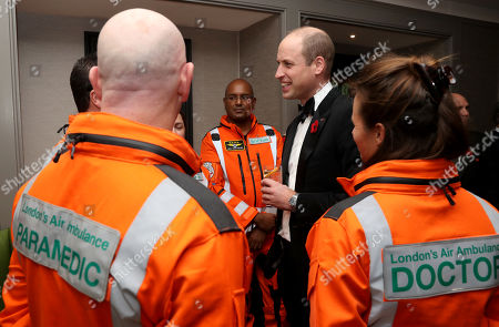 Prince William speaks with Doctor Flora Bird, Consultant in emergency medicine at the Royal London Hospital, Paramedic Steve Jones and Doctor John Chatterjee, Anaesthetic Consultant at Guys and St Thomas Hospitals, as he attends the London's Air Ambulance Charity gala