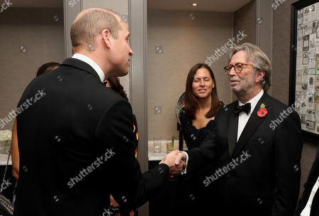 Stock Picture of Prince William and Eric Clapton attend the London's Air Ambulance Charity gala