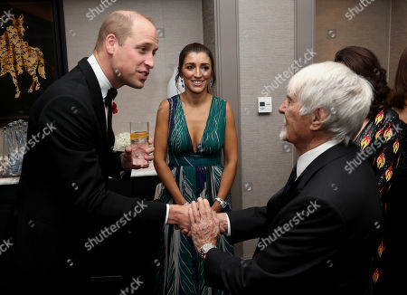 Prince William with Bernie Ecclestone and guests as he attend the London's Air Ambulance Charity gala