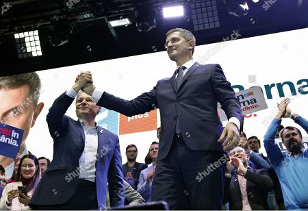 USR (Save Romania Union) party leader Dan Barna (R) shakes hands with Dacian Ciolos (L), the leader of the Freedom, Unity and Solidarity Party (PLUS), during a USR-PLUS alliance rally held in Bucharest, Romania, 07 November 2019. Dan Barna of USR is running for a presidential mandate on behalf of USR-PLUS alliance in the presidential race that will be held in November 2019, and if he wins, Ciolos will be nominated as Prime Minister. In May 2019, Ciolos was elected a member of the European Parliament, and after he was chosen as the leader of the new Renew Europe political group.