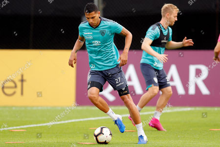 Stock Photo of Fernando Leon of Ecuador's Independiente del Valle dribbles the ball during a soccer training session at the Defensores del Chaco Stadium in Asuncion, Paraguay, . Independente del Valle will play against Argentina's Colon on Saturday in the Copa Sudamericana final match