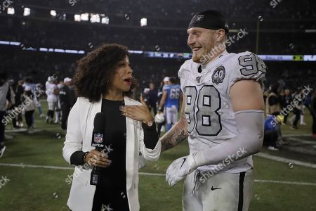 Oakland Raiders defensive end Maxx Crosby (98) talks with MJ Acosta after an NFL football game between the Raiders and the Los Angeles Chargers in Oakland, Calif