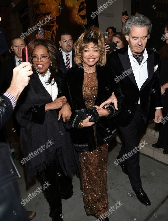 """Stock Image of Oprah Winfrey, Tina Turner, Erwin Bach. Singer Tina Turner, center, arrives with Oprah Winfrey, left, and husband Erwin Bach for the opening night of """"Tina - The Tina Turner Musical"""" at the Lunt-Fontanne Theatre, in New York"""