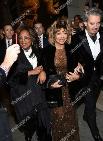 """Stock Picture of Oprah Winfrey, Tina Turner, Erwin Bach. Singer Tina Turner, center, arrives with Oprah Winfrey, left, and husband Erwin Bach for the opening night of """"Tina - The Tina Turner Musical"""" at the Lunt-Fontanne Theatre, in New York"""